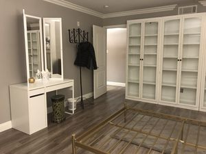 Queen bed, area rugs, leather couch, lamp, side table, huge mirror, dresser, vanity, candle, green stool, storage shelves, everything for sale. for Sale in Las Vegas, NV