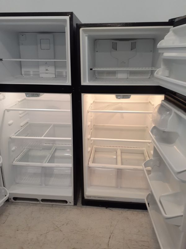 Frigidaire stainless steel top freezer refrigerator in good condition with 90 day's warranty