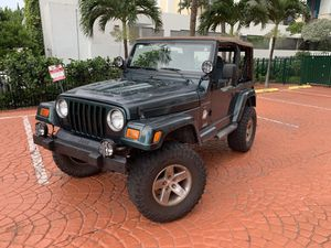 1999 Jeep Wrangler Sahara with 98k miles and auto trans for Sale in North Miami Beach, FL