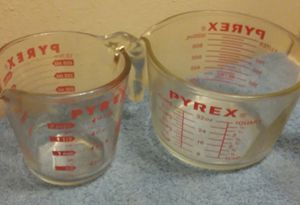 2 glass pyrex measuring cups for Sale in York, PA