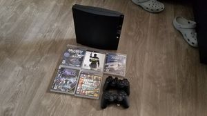 PS3 slim. 2 controllers. 5 games for Sale in Haines City, FL