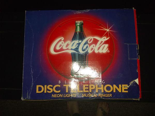Coca cola disk telephone