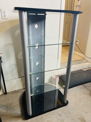 Like NEW Tv stand / tower with glass shelves for Sale in Paradise, NV