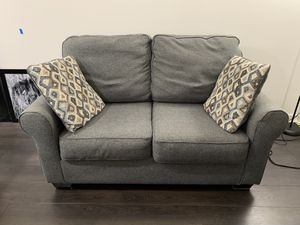 Ashley Loveseat with Pillows and OPTIONAL Storage Ottoman (extra charge) for Sale in Chicago, IL