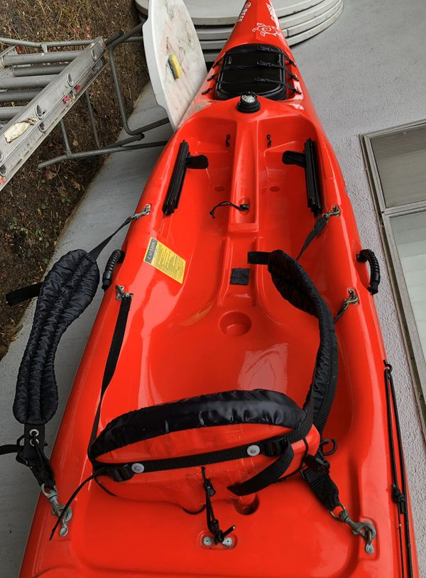 Red 16 ft. kayak. The Tarpon160 with double hatches for storage. Sit on top kayaking . Paddle included.