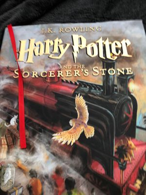 Harry Potter and the sorcerer's stone hard cover with pictures for Sale in Chico, CA