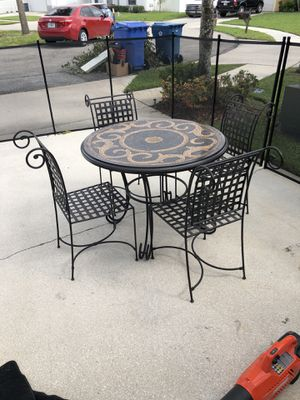 Dinette set. Mosaic table with (4) chairs (Cushions not included). Very good condition. Motivated to sell. No reasonable offer will for Sale in FL, US