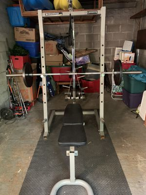 Powerhouse cage and free weights for Sale in Northbridge, MA