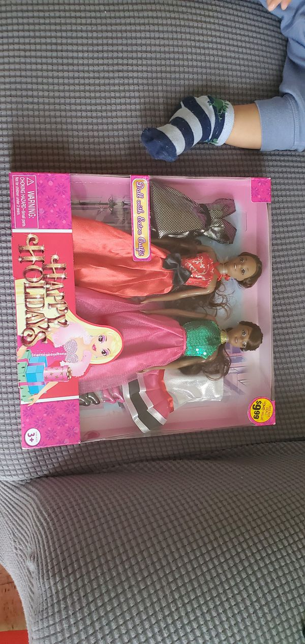 Two Dolls with two outfit