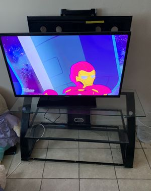 Flat screen Samsung + Tv Stand comes with. for Sale in Lehigh Acres, FL