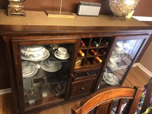 Elegant wooden hutch. Optional dining table with a total of 8 chairs. Can purchase as a set or individually. Must pick up. for Sale in West Springfield, VA
