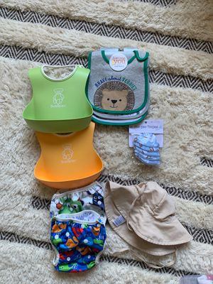 Assorted Baby Gear - bibs, peepee teepee, sun hat and swim diaper for Sale in Hawthorne, CA