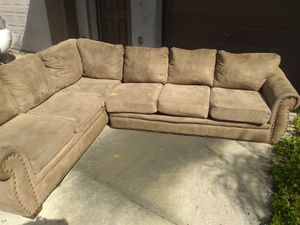 Sectional with pull out bed for Sale in Tampa, FL