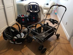 Joovy Twin Roo+ Stroller with Graco Click Connect adapters, two (2) Graco Snugride Click Connect 35LX car seats, two (2) bases, and manuals. for Sale in Winter Springs, FL