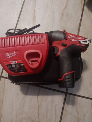 New Milwaukee drill m12 charger and battery include for Sale in Phoenix, AZ