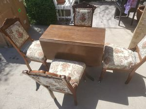 Beautiful 1940s Duncan phyfe style vintage antique drop leaf table with four chairs for Sale in Phoenix, AZ