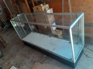 "Glass case showroom with wheels size 70"" length x20"" width x40"" height for Sale in Lincoln Acres, CA"