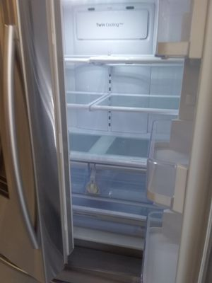 Samsung French doors stainless steel refrigerator used good condition 90days warranty for Sale in Mount Rainier, MD