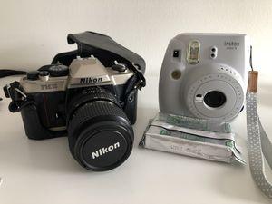 Instax Polaroid Mini with one film cartridge and Nikon F10 camera for Sale in Washington, DC