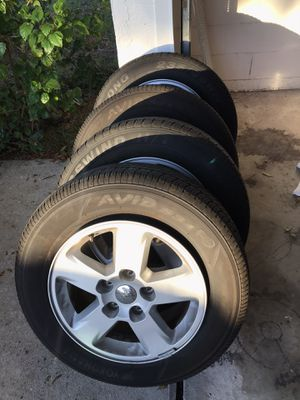 Jeep Tires and Rims - P235/65R17 for Sale in Kissimmee, FL