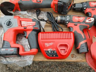 The Hammer Drill Brand New Battery Charger Multi Tools Like New Drills Like No for Sale in Providence,  RI