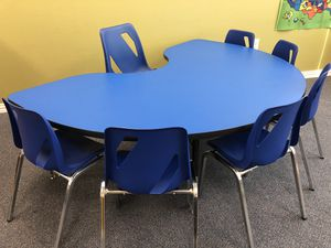 Adjustable kidney table, with a teacher chair and 6 students chairs. Small tray shelf, high storage unit and low storage unit. for Sale in Sugar Land, TX