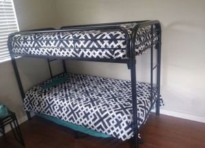 Twin over twin bunk bed frame new in the box with the mattresses and free shipping for Sale in Hialeah, FL
