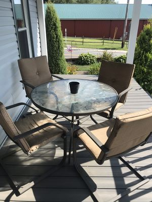 Outdoor table with glass top and four chairs for Sale in Findley Lake, NY