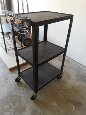 Metal shelve with electric cord for Sale in Missouri City, TX