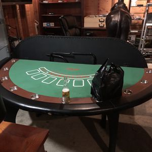 Blackjack table little rip that is being fixed with black electric tape besides that in pretty good condition for Sale in Glen Ridge, NJ