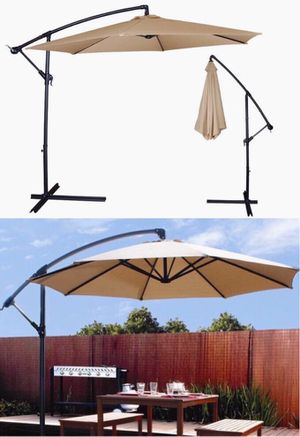 New in box $65 each 10 feet offset off set umbrella tilt crank with cross stand included paraguas for Sale in Whittier, CA