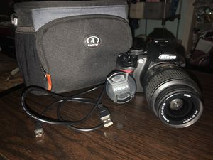 Nikon D3100 Bundle: camera, lens, lens cover, tamrac bag, adaptor for Sale in Buffalo, NY