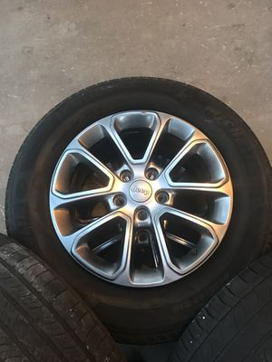 Jeep Grand Cherokee stock wheels. Rims are good just gonna need tires pretty soon. for Sale in Visalia, CA