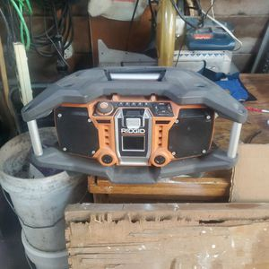 Rigid Shock Mount Radio, Am/Fm. Ipod Works. Rigid Battery Powered Or Plug In for Sale in Mentor, OH