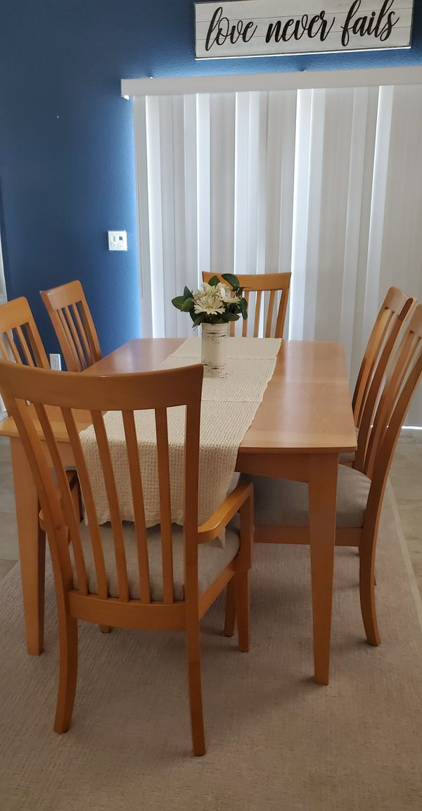 Solid maple table with new recovered chairs in modern fabric with another leaf