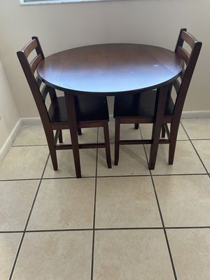 Solid wood kitchen table with 2 chairs. for Sale in Lehigh Acres, FL