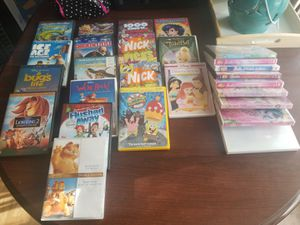 CHILDREN'S DVD'S AND DVD WIRE RACK for Sale in Arlington, TX