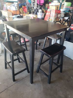 Solid wood black counter dining set table and 4 benches for Sale in Downey, CA