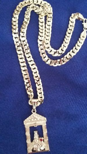 Very nice 14kt gold over stainless steel 26inch Cuban link Chain with nice Santa Barbara charm for sale !! for Sale in Tampa, FL