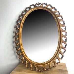 Vintage Syroco 1964 ornate bronze oval mirror for Sale in Rialto, CA