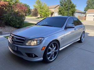 """2009 Mercedes C63 AMG 138,000 miles Very well-maintained always garaged and covered AMG rear window spoiler and AMG trunk spoiler staggered 20"""" rim for Sale in Brighton, CO"""