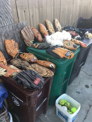 There is 20 baseball gloves 16 softballs 22 hard balls para cleats some three pairs of batting gloves and a couple of other things take them all fo for Sale in San Lorenzo, CA