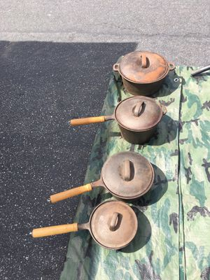Cast iron pans pots with lids for Sale in Bell Gardens, CA