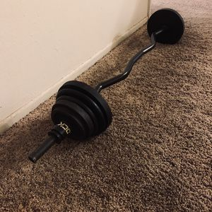Curling bar and weights 2-10s 2-7.5s 4-5s 2-2.5s 60 pounds in total for Sale in Rancho Cucamonga, CA