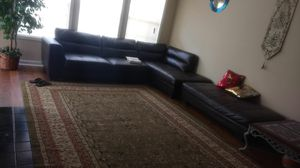 Rooms to go 100% pure leather L shape sofa and ottoman with a beautiful carpet for Sale in Franklin, TN