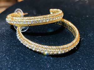 Beautiful Gold toned earrings with brilliant imitation diamond along the outer circumference. for Sale in Lavon, TX