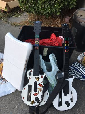 Nintendo Wii console controls and guitars for Sale in Riverside, CA