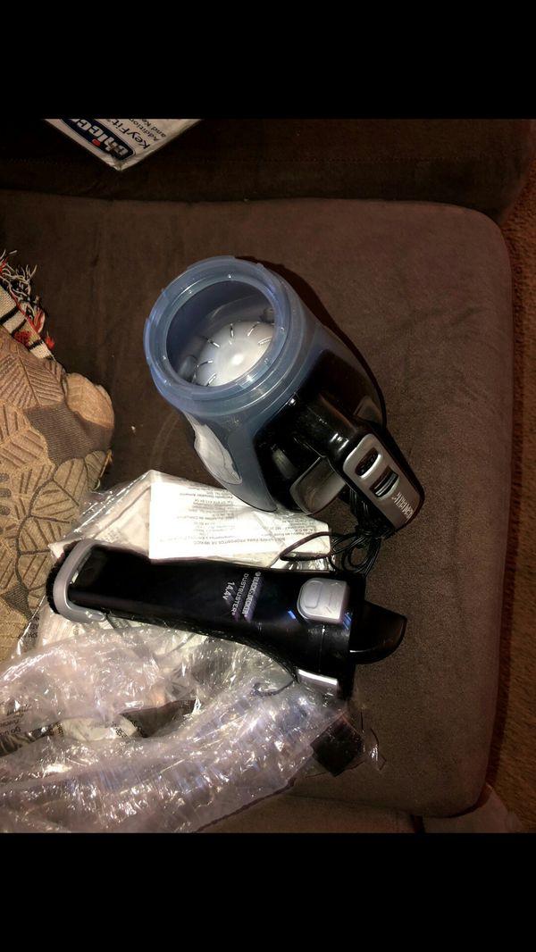 Brand new Black and Decker Portable hand held vacuum