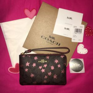 NEW WITH TAGS COACH AUTHENTIC SIGNATURE C PINK METALLIC STARS CORNER ZIP WRISTLET COMES WITH COACH BOX COACH TISSUE AND COACH STICKER for Sale in Miami, FL