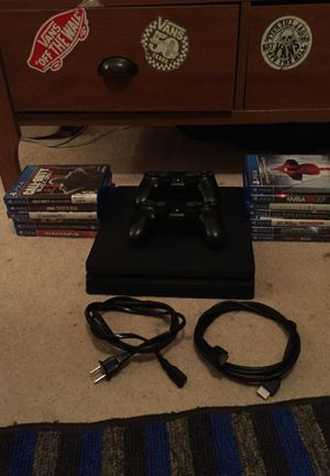 PS4 slim w/t 13 games and 2 controllers, for Sale in Lilburn, GA